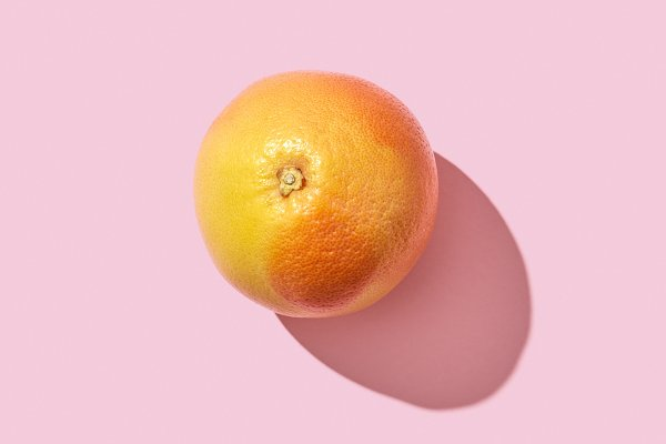 Food Stock Photos: Yaroslav Danylchenko - Whole juicy grapefruit presented on