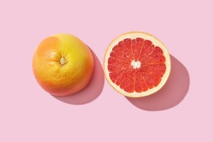 Two halves of a ripe grapefruit on a