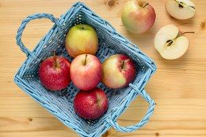 Red apples in blue wooden basket