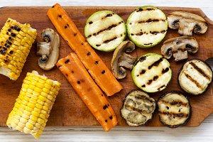 Grilled vegetables on wooden board