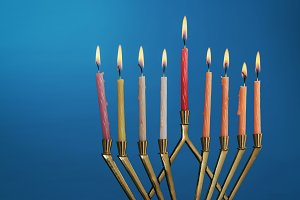 Lit of hanukkah candles in menorah