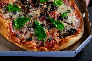 Delicious fresh baked pizza in box