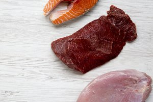 Uncooked raw salmon steak, beef meat