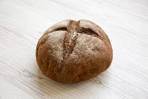 Freshly baked bread on white wooden