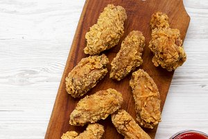 Chicken wings on a rustic wooden