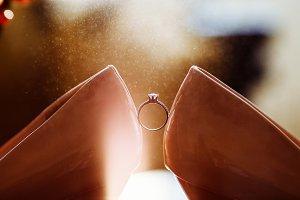 Bride's jewel ring between women's s