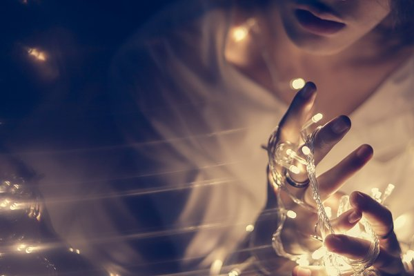 Beauty & Fashion Stock Photos: Nuchylee Photo - Young man hand holding light