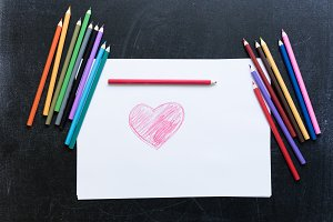 Red heart on white paper drawn by