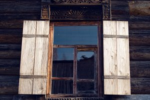 window with glass in old log in