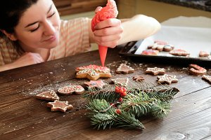 Girl making Christmas ginger biscuit