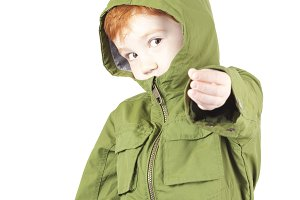 child in a green jacket