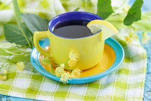 Cup of herbal tea with linden blosso