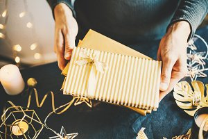 Man showing wrapped gifts