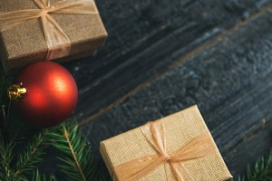 two Christmas gifts on a dark wooden