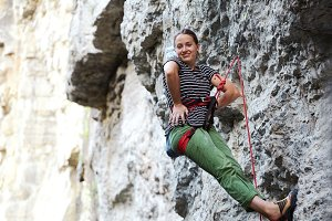 girl rock climber resting while