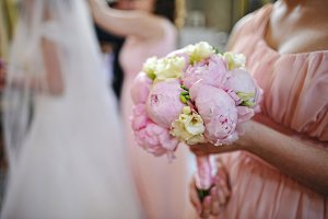 Wedding bouquet of peony at hand of