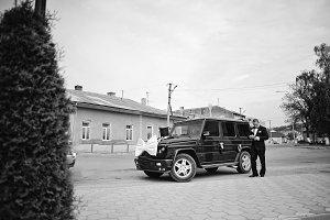 Stylish groom near maffia car at wed