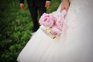 Tender wedding bouquet of peonies at
