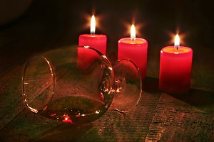 Glass of brandy or cognac and candle