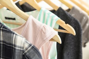 Hangers with woman clothes wardrobe.