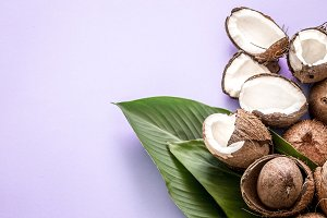 coconut halves with tropical leaves