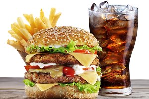 Hamburgers, French fries and cola on