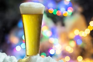 Glass of beer with magic Christmas l