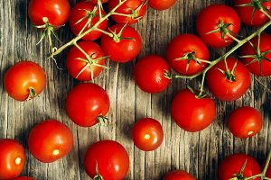 Fresh tomatoes on wooden background.