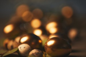 close up of easter golden eggs and q