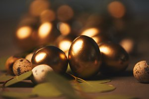 close up of easter golden eggs with