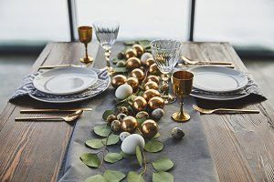 easter golden eggs, plates and glass