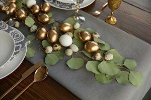 golden easter eggs on green leaves o