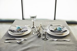 plates with easter eggs on table in