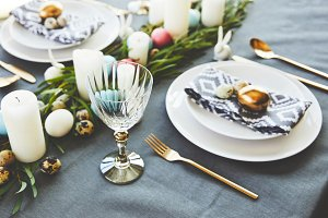 easter decorated table with eggs in