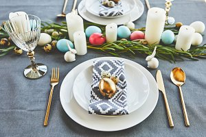 easter eggs and candles on festive t