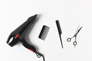 top view of hair dryer, combs and sc