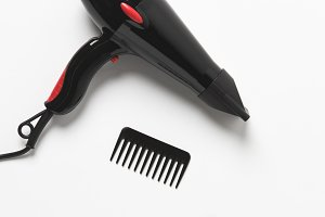 top view of hair dryer and two combs