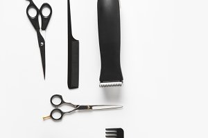 flat lay with hair clipper and haird