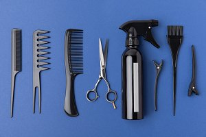 flat lay with black hairdressing equ