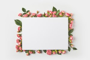 blank card and beautiful pink roses