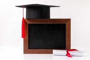 Square academic cup on empty blackbo