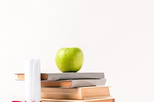 Diploma with stack of books with app