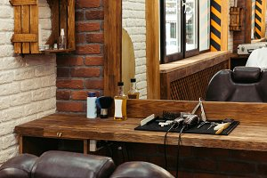 professional barber tools on wooden
