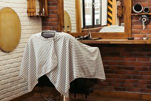 empty chair at modern barber shop in