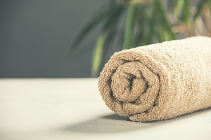 Brown Towel on concrete background -