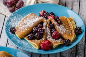 Homemade crepes with frozen berries,