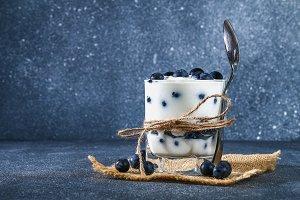 Yogurt with blue blackthorn berries