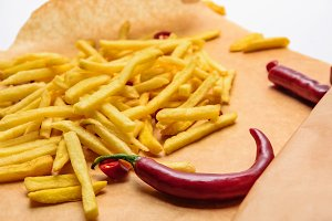 tasty french fries with spicy pepper