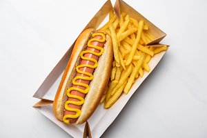 top view of tasty hot dog with fries