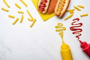 top view of hot dogs with mustard an